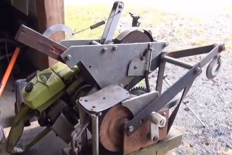 Chainsaw Winch by  -- Homemade chainsaw winch assembly powered by a Poulan 361 chainsaw. Winch drum is coupled to the chainsaw drive socket. http://www.homemadetools.net/homemade-chainsaw-winch