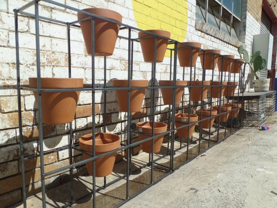 Vertical garden to hold 6 pots. Or use multiple от IndustriaMetal