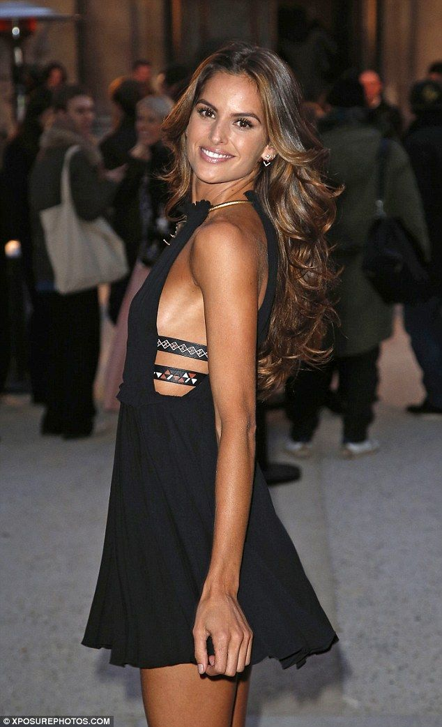 The money-makers: Izabel offered a glimpse of her chest as the LBD featured cut-out panels...