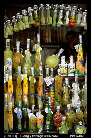 Bottles of Lemoncelo, the local lemon-based liquor, Amalfi. Amalfi Coast, Campania,
