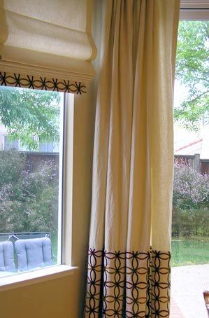 Love the detailed banding on these drapery panels and roman shades.