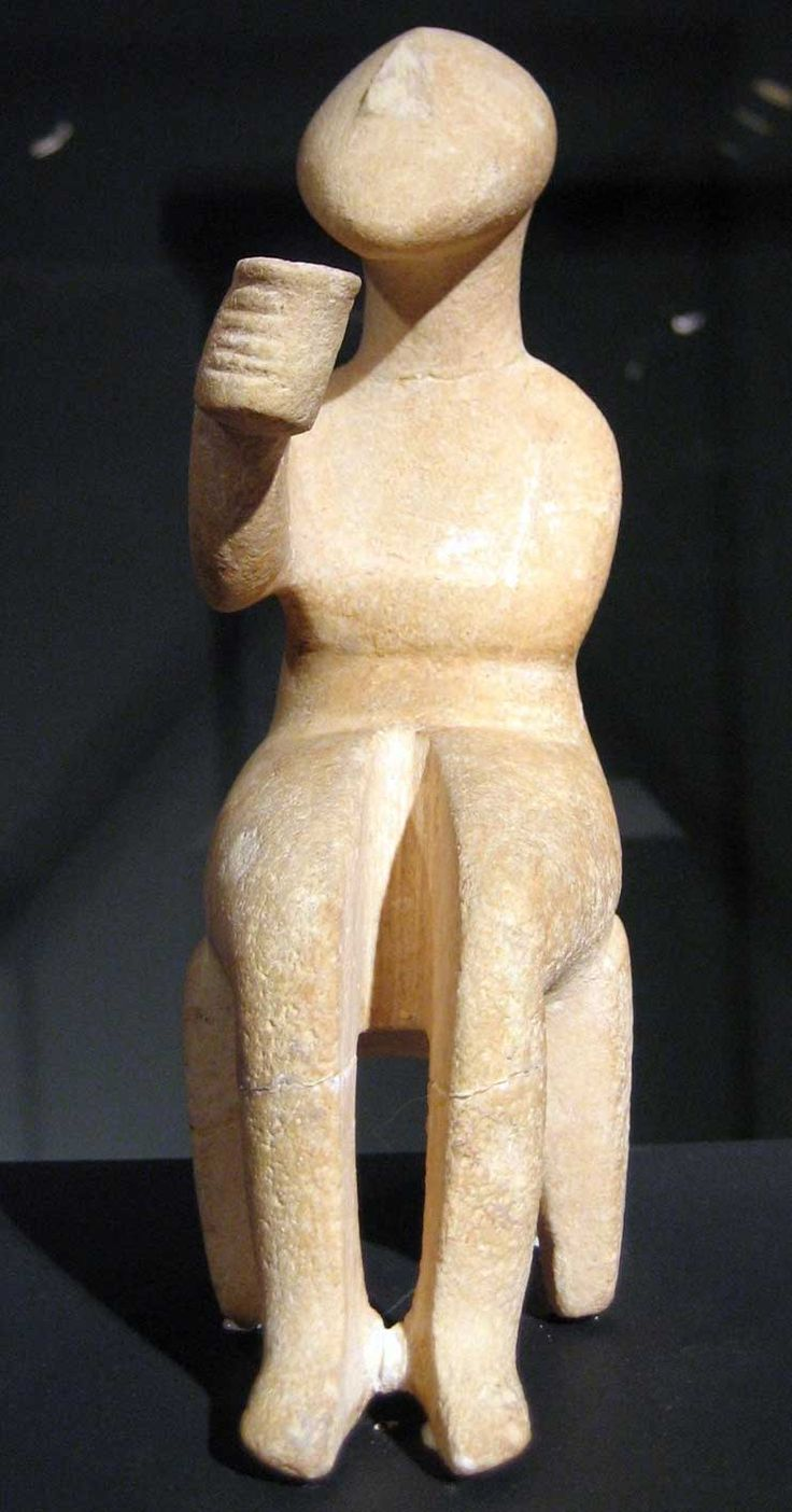 Cycladic figurine called 'the cup bearer'. Hmm ...  I don't know. Isn't a cup bearer walking or moving in a procession? This man is sitting down enjoying  some damn good beverage