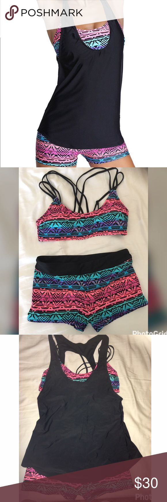NWOT Women's tribal bathing suit with tankini top Tribal print 2 piece boy shorts style bottoms with tankini tank top. NWOT. Never worn Swim Bikinis