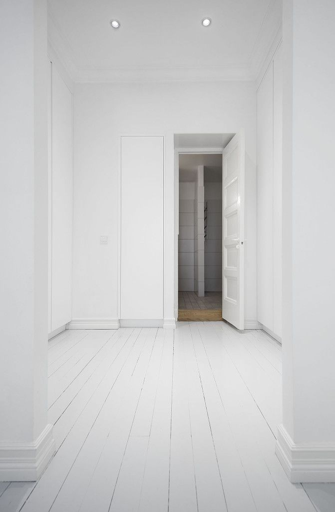 Interior design, Scandinavian home, all white walk-in closet painted planks grey hardwood floor