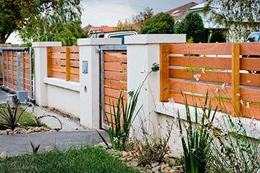 Horizontal Wooden Boards Stucco Columns Fencing