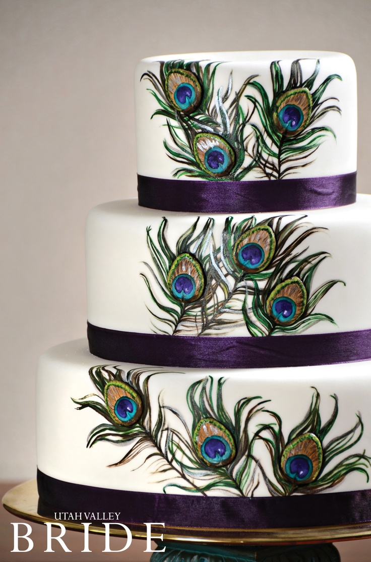 Vibrant, hand-painted peacock feathers on a three-tiered stunners by Wedding Cakes by Dawna.