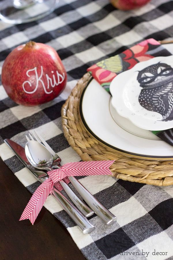 Names written on pomegranates with paint pens for unique placecards & silverware tied with ribbon - perfect for a holiday table!
