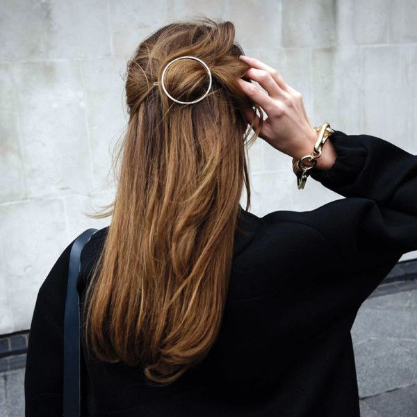 The Circular Barrette - It's official: Barrettes are back. Rather than sweeping hair half-back with traditional bobby pins, swap for a circular hair clip, which feels modern yet still effortless (and appropriate for daytime errands and evening fetes alike).