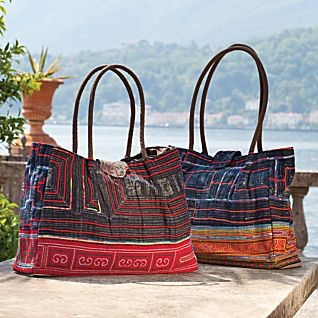 The Hmong ethnic group is one of the few societies in the world who still makes most of its own clothing, starting with thread purchased at the village market. The handwoven linen and cotton of this roomy indigo tote was once part of a Hmong skirt. Features hand-embroidered accents. Handcrafted in Vietnam. Designs will vary due to the vintage materials.