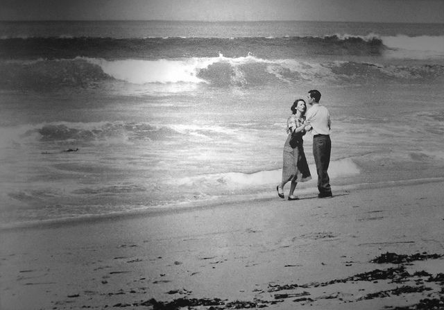 """Tragedy by the Sea  1955 Pulitzer Prize, Photography, John L. Gaunt, Los Angeles Times  Down by the water, Gaunt finds a distraught young couple by the shoreline. Moments before, their 19-month-old son was playing happily in their yard. Somehow, he wandered down to the beach. He was swept away by the fierce tide.  The little boy is gone. There is nothing anyone can do. Gaunt, who has a daughter about the same age, takes four quick photographs of the grieving couple. """"As I made the…"""