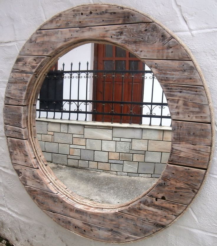 A big, bold statement for your home or for a bar, hotel reception, restaurant, taverna or shop. Upcycled from an old wooden cable reel. The circumference of this piece is a whopping 120cm. The circular wooden construction beautifully frames this mirror. The outer edge of the mirror is finished off with four strands of rope (found on the beach), and one piece of the same rope lines the inner edge.