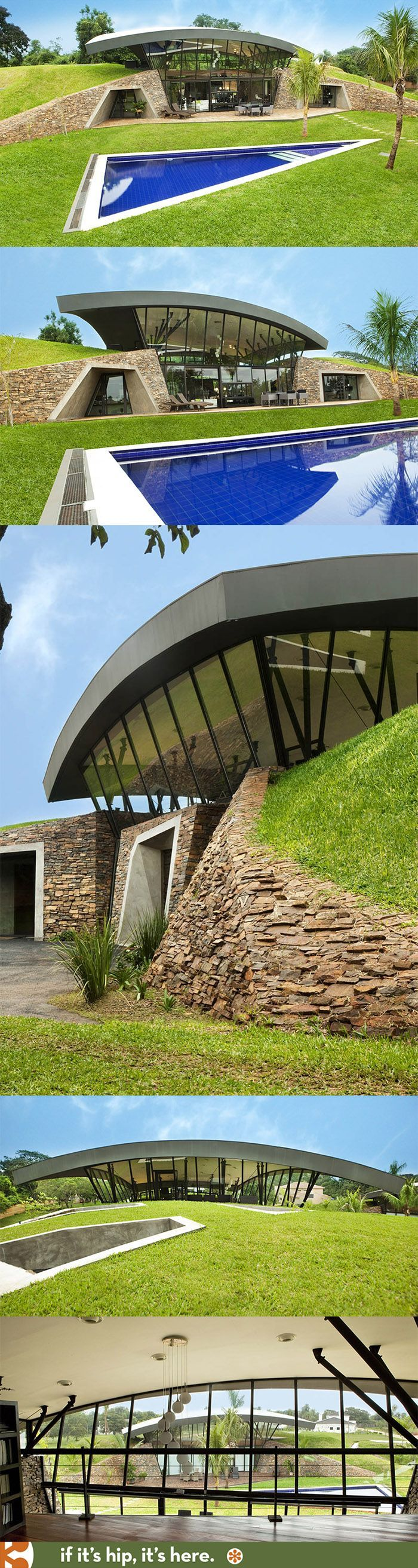 Two partially submerged modern homes with arched living roofs make a green haven in Paraguay.