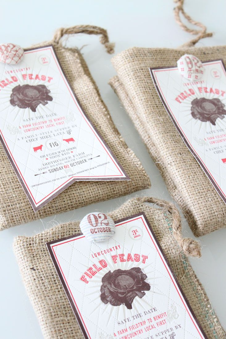 Letterpress invitations by Stitch Design Co, the 2011 Field Feast save the dates. This year, the invites were printed 3 color letterpress, die-cut and attached to a burlap bag with a custom wrapped fabric button.