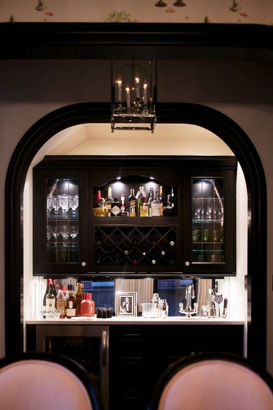 trad cabinets. wine+ bottle storage. mirror splash back.