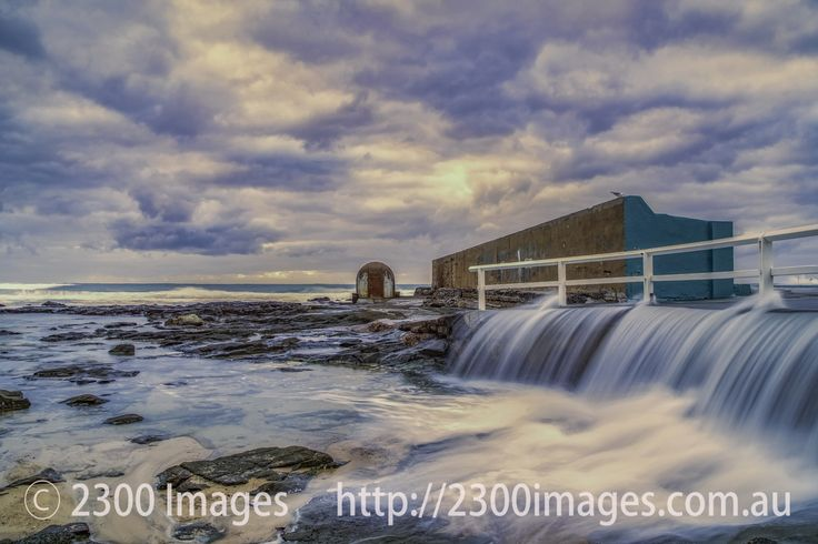 Early Morning Overspill at Newcastle Ocean Baths. - Early Morning Overspill at Newcastle Ocean Baths, Newcastle, NSW, Australia.
