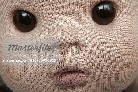 Close-up of doll face made of knitted fabric