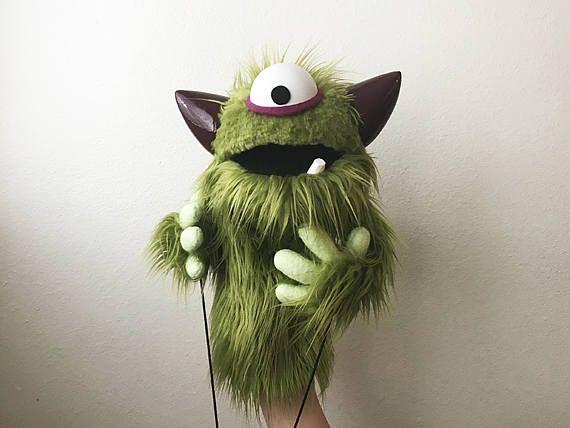 Profesional verde Cyclops peludo monstruo marioneta