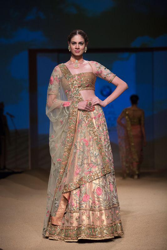 Ashima Leena pink floral accents on lehenga. More here: http://www.indianweddingsite.com/bmw-india-bridal-fashion-week-ibfw-2014-ashima-leena/