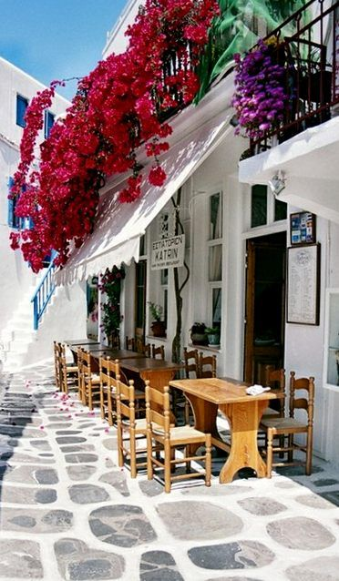cafe - LOVE the street. A wooden floor, whitewashed with big polka dots on the floor?