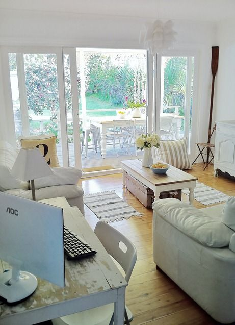 beach cottage family room decor just proves that white walls don't have to look dull, plain or boring