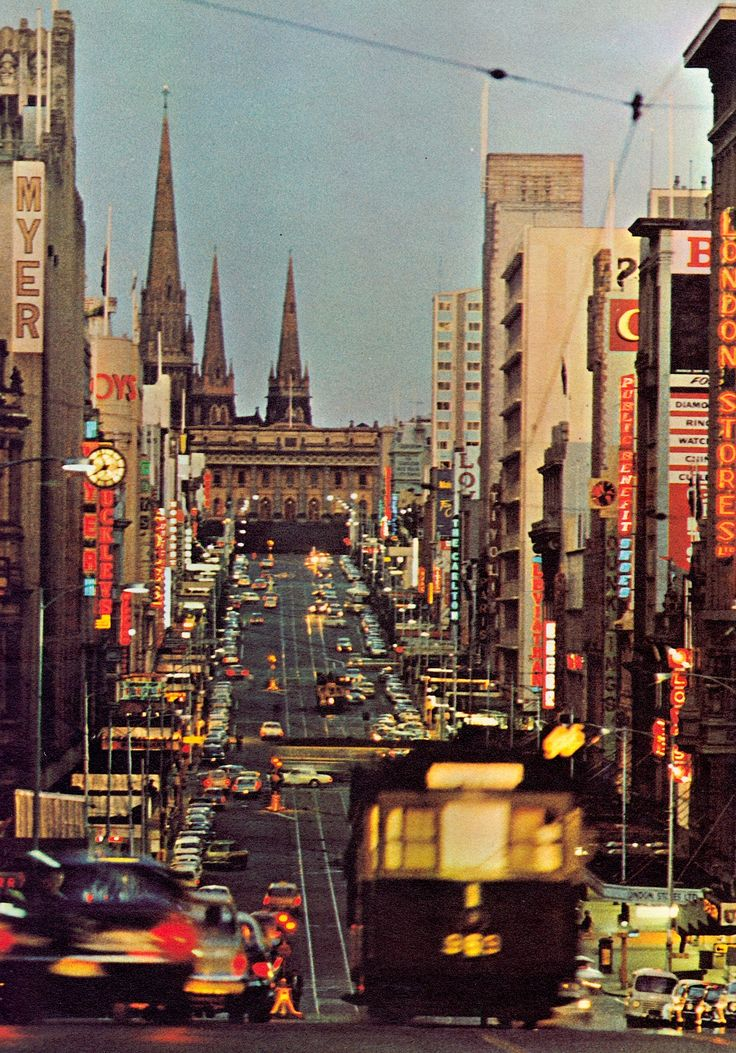 MELBOURNE CITY Bourke Street looking towards Parliament House. 1960's. I love the old green wooden seated trams we call 'rattlers'. You just don't see that many of them anymore, except occassionally on Chapel Street, or in the iourist areas. Photo (detail) by Mark Strizic. Image from Graham Kennedy's Melbourne 1967. (minkshmink on pinterest)