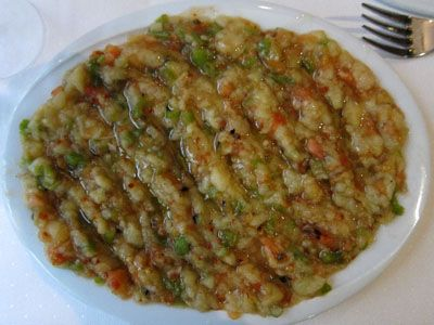 Abugannus; mashed roasted eggplant with tomatoes and green peppers