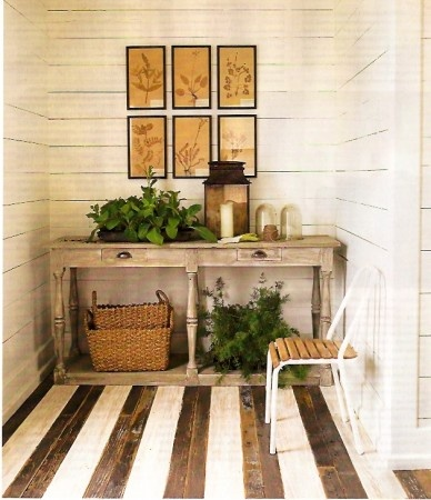 Neutral entry. Striped painted floors. Rustic.