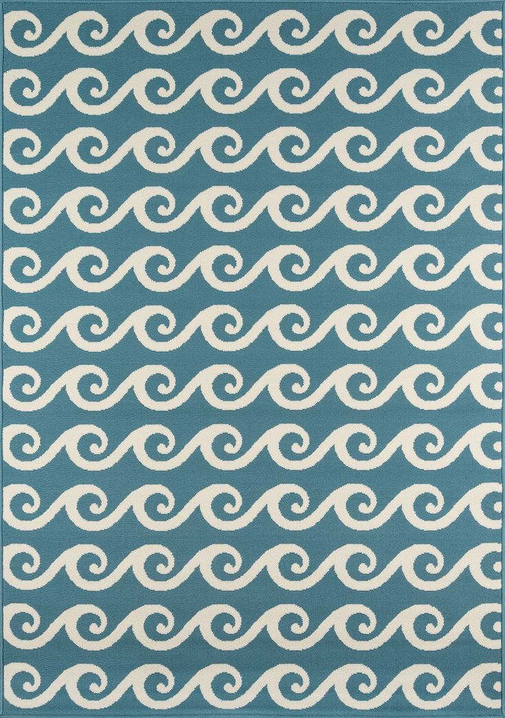 Right at Home: Water Themed Decor  Sometimes a stylized pattern successfully brings the theme home in a subtle way. Momeni's simple geometric repeat of a wave motif works beautifully on an indoor/outdoor rug at Target.