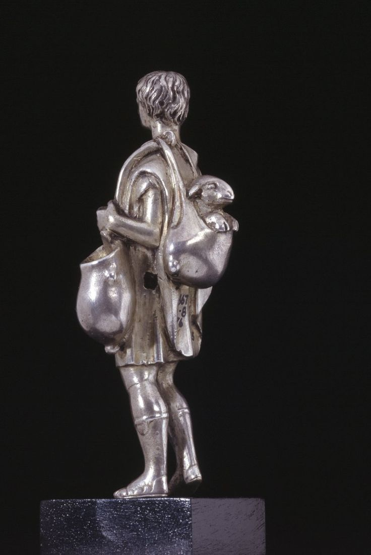 Silver statuette of a shepherd carrying a sheep in a skin bag slung over his shoulder. Roman (?). 1st century A.D. (?) | The British Museum