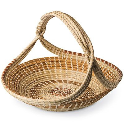 Sweetgrass Baskets are coiled baskets made of sweetgrass harvested in the spring and summer on the edge of the dunes near the ocean, often decorated with longleaf pine needles and woven together with strips of palmetto leaves.