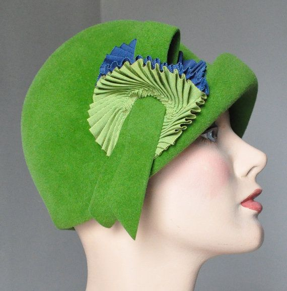 """Green felt cloche with double cockade of blue and green grosgrain ribbon, Italian, 1960s. Label: """"Betmar / New York / Paris"""" and [stamped] """"Luxuria / Imported Body / Made in Italy"""""""