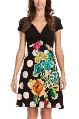 Nos encanta celebrar la diferencia y sorprenderte con ella. Este vestido con escote con nudo tiene uno de los estampados insignia de la colección Why?: los topos. Que aquí, vienen con flores grandes y colores vivos.