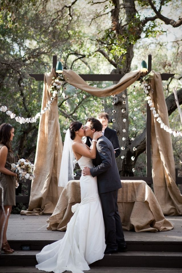 rustic wedding arch, draped with burlap, to add a little more of a country feel to our outdoor wedding