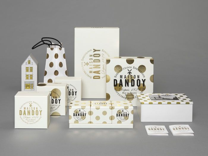 Maison Dandoy package design- a new visual identity for Brussels' most famous biscuit bakery with a pattern taking its inspiration from baked cookies being taken out of the oven