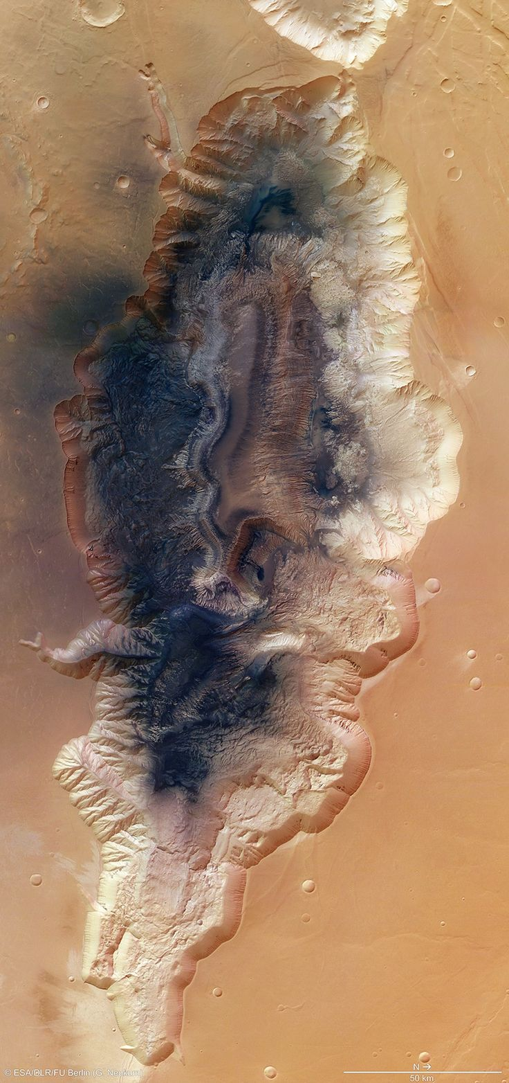 Mars is a world of extremes. Even a medium-sized canyon named Hebes Chasma on the Red Planet would rank among the biggest on Earth. Imagine ...