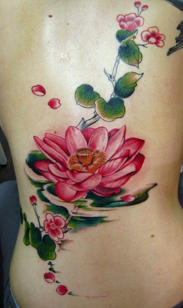 Beautiful red  lotus tattoo on ribs