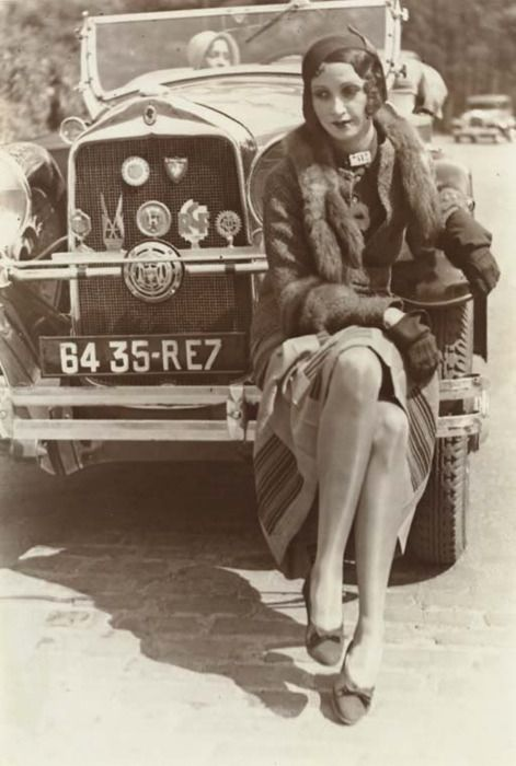 "Photo of women and car from the 1920's, (also note the woman in the car)  My title for photo: ""I wonder what she is thinking about..."""