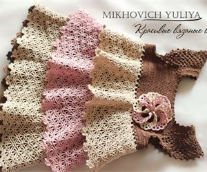Crochet delicate colorful dress for a girl