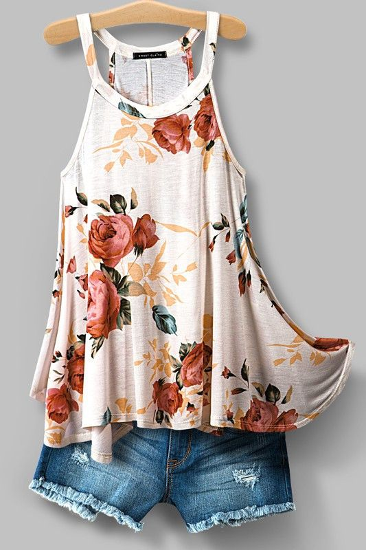 Floral print racercback high neck top. Flowy and relaxed fit. 100% rayon. SHIPS AROUND MID JUNE 2016