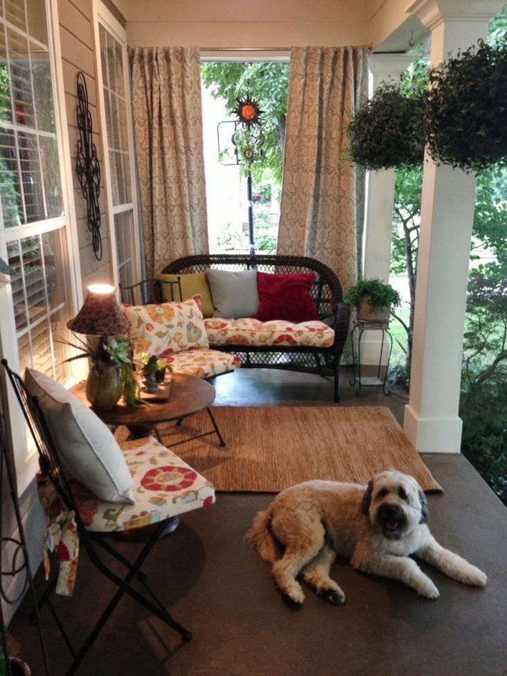 Front porch, stained concrete, outdoor furniture, outdoor curtains. Such an adorable and welcoming front porch!