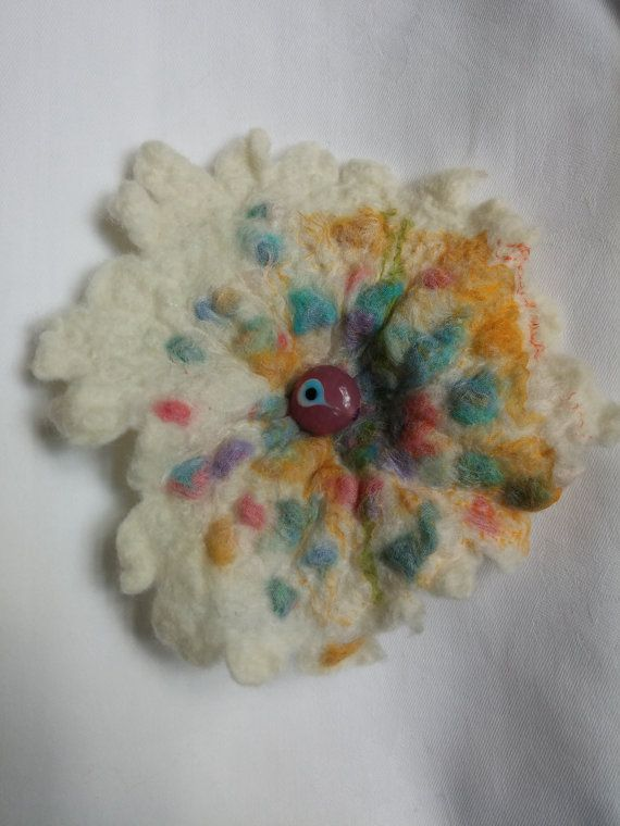 A delightful and unique handmade multicoloured felt flower brooch made from soft natural undyed merino wool. I have embellished it with coloured wools and a glass bead Blyth Whimsies