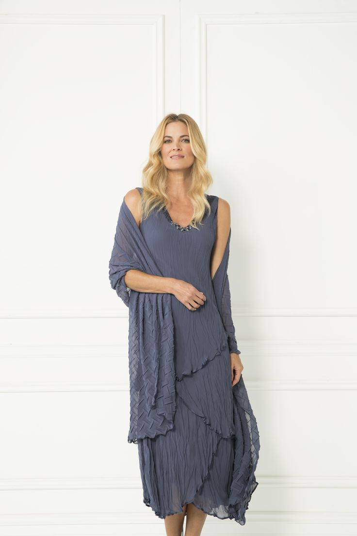 The perfect dress for any occasion. Whether it be a wedding or birthday party, this dress with matching scarf will be your go to outfit throughout the year.