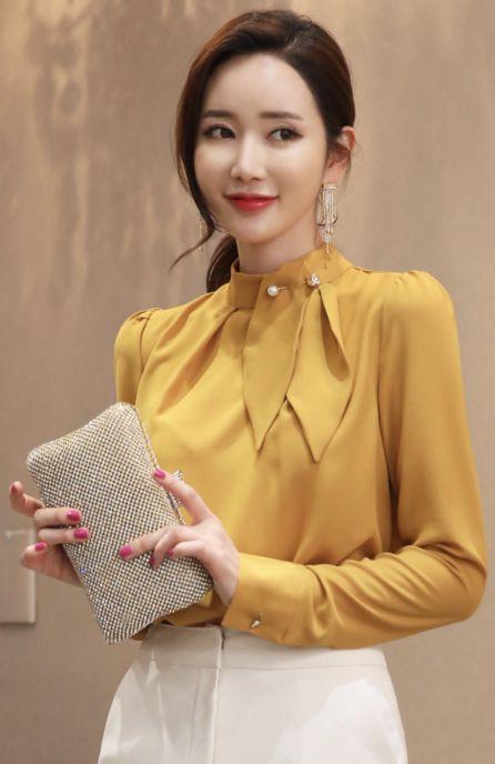 StyleOnme_Brooch Set Neck Tie Detail Blouse #mustard #pearl #blouse #elegant #koreanfashion #kstyle #kfashion #winterlook #seoul