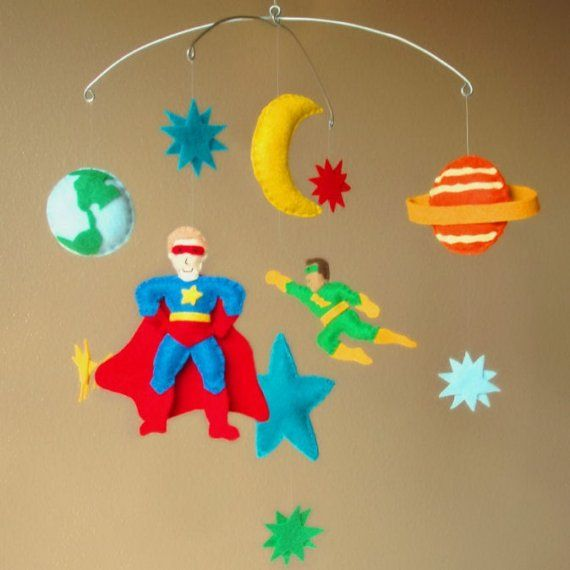 Superhero Space Adventure Baby Mobile - Super Heros, Earth, Jupiter Planet, Moon, Star (Custom Felt Colors Available). $115.00, via Etsy.