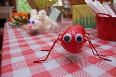 Red ants and picnic tablecloth - made from golf balls and coat hangers #bugs #garden #picnic #birthday