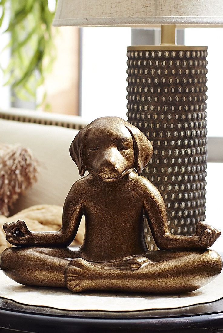 One thing is certain: When you tell this gold terracotta Pier 1 Yoga Dog to sit, he's guaranteed to stay. In fact, he might encourage you to do the same and join him in meditating. Either way, like any good pooch, he's most concerned with contributing to your happiness.