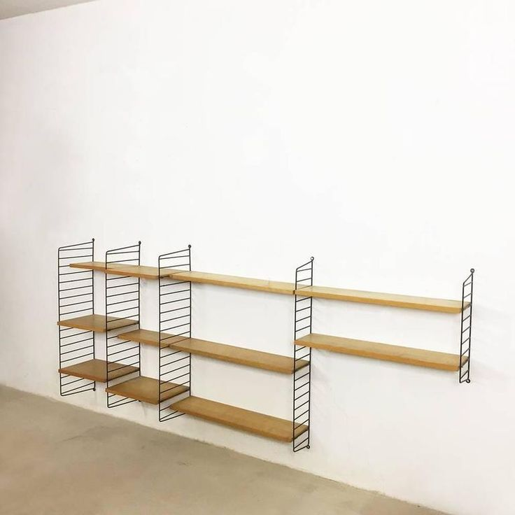 Modular String Wall Unit  https://www.1stdibs.com/furniture/wall-decorations/shelves-wall-cabinets/original-1960s-modular-string-wall-unit-elmwood-nisse-strinning-sweden/id-f_6783001/    See also:  24 Uberstylish Modular Wall-Mounted Shelving Systems  http://vurni.com/modular-wall-mounted-shelving-systems/