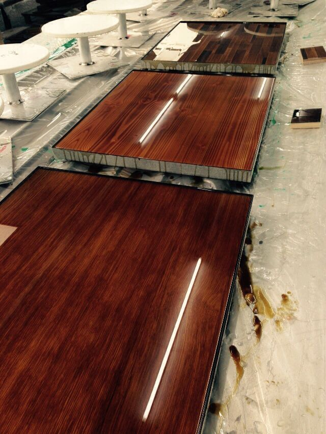 Wooden tabletops with soft sand bron colour coating Ccoating.nl