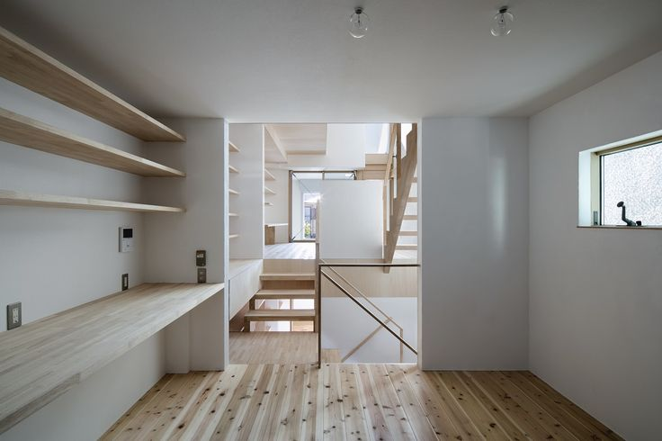 Interesting space with lots of shelving and stairs