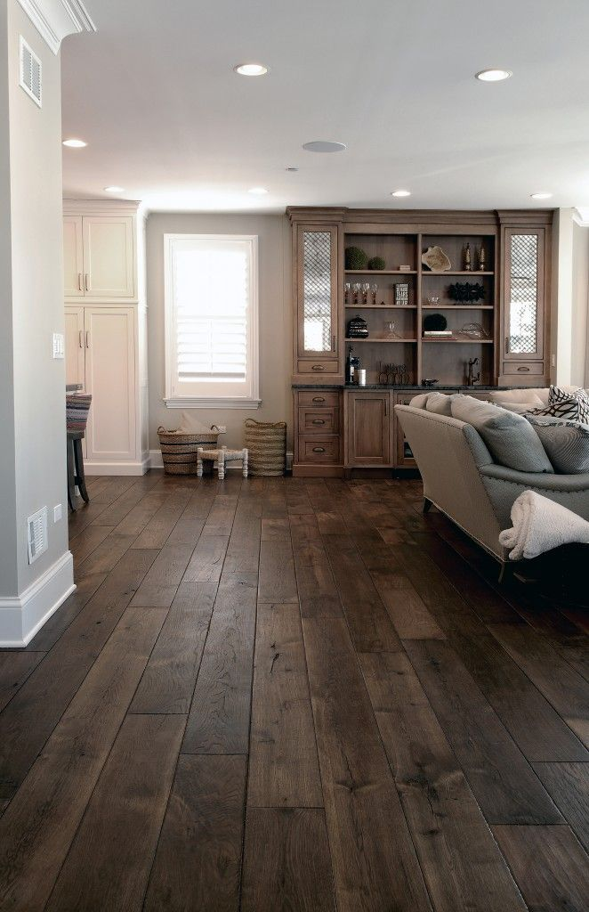 Wide Plank Hardwood Floors With White Baseboards And White Toe Kick